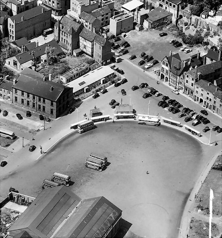 The old Broad Marsh bus station, Nottingham, about 1950s. Roads in the photo are: New Bridge Street, running bottom left to centre, with Canaan Street going off centre left, Broad Marsh, running top centre to centre right, and Sussex Street running centre right to bottom right. The viaduct is just out of shot to the right of the photo.