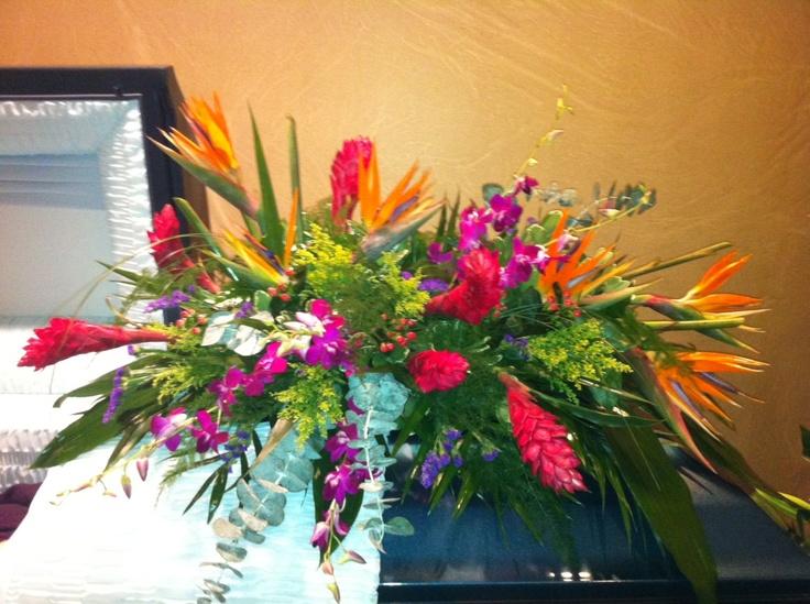 Casket spray with tropical flowers favorite flower