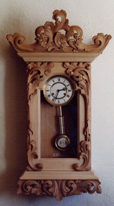 Beautiful example of Norwegian carved wall clock.