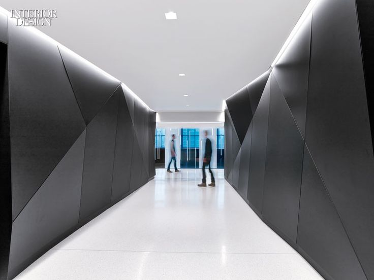Composes a Perfect Harmony at Sony's US Headquarters Office. Walls of blackened steel define an elevator lobby.