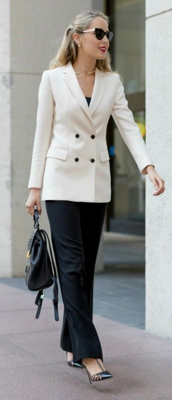 ivory double breasted blazer, wide leg high waisted black wool trousers, sjp collection carrie pumps, leather backpack handbag