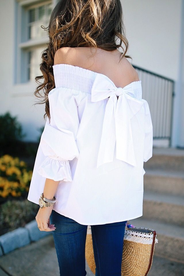 Bow back off the shoulder top.