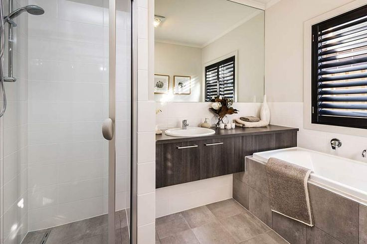 This stylish bathroom features muted colours to give a relaxed, earthy atmosphere. #weeksbuildinggroup #newhome #homedesign