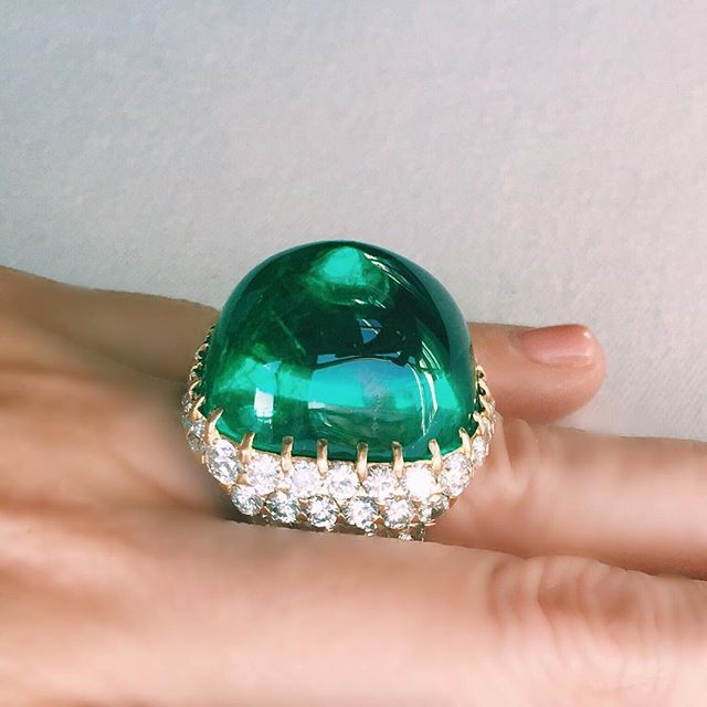 A Colombian cabochon emerald and diamond ring.