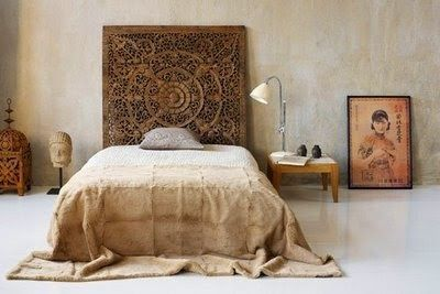 love the carved wood piece as headboard...if only I could find a piece like that!