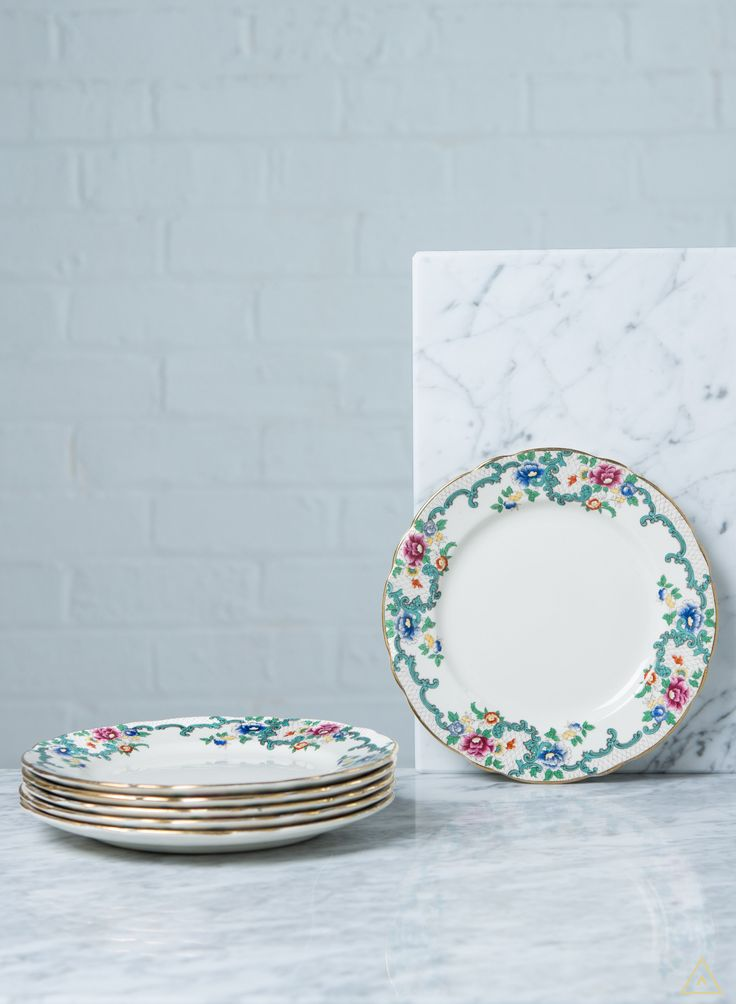 Two serving plates and sauce 'boat' designed with multicoloured borders and gold edge.  Explore interior design inspiration and shop vintage furniture, antique furniture, contemporary furniture and mid-century designs.