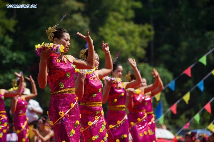 People dance in Feihong Village of Mangshi City, Dai-Jingpo Autonomous Prefecture of Dehong, Yunnan Province, April 11, 2015. Dai people in Mangshi City held celebration for the coming Water-Splashing Festival on Saturday http://www.chinatraveltourismnews.com/2015/04/celebration-for-water-splashing-festival.html