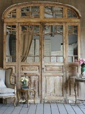 The coolest doors ever... we would love these at the end of our dining room, mirrored with old glass...The Paris Apartment. (nfs)
