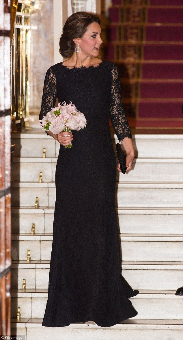 Glamorous: The pregnant Duchess of Cambridge glowed with health as she left the event armed with a bouquet of flowers.