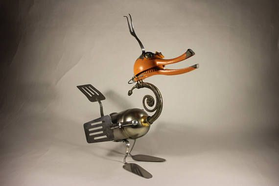 recycled art,metal sculpture art,stainless steel,recycled metal,found objects,upcycled art,metal assemblage,industrial waste Found object sculpture,made from aluminum lemon squizer,used lamp parts ,stainless steel fork,stainless steel spatulas Oswald is about20 inches high , 8