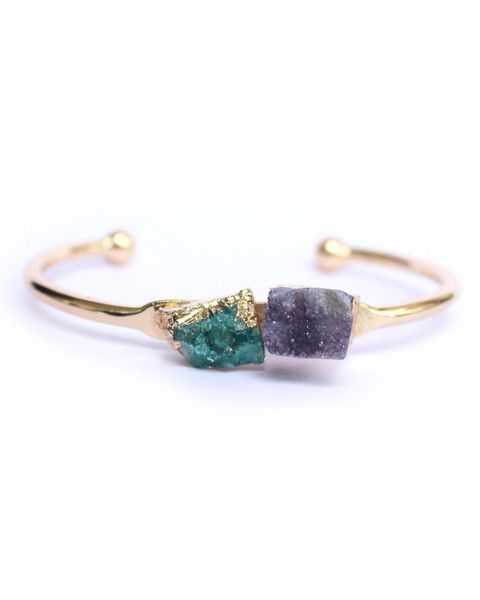 Druzy quartz gemstone set on a circular bar in gold color. Great worn alone or layered with others for an on-trend look.