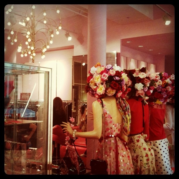 Oh Alanna Hill, you always get it so right.  Flower bombed heads for the mannequins and look at that chandelier in the background.