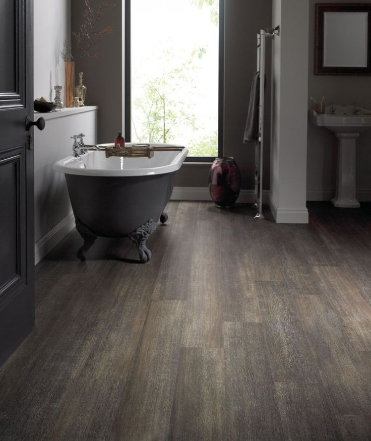 Vinyl flooring warm browns and planks on pinterest for Warm feel bathroom floor tiles