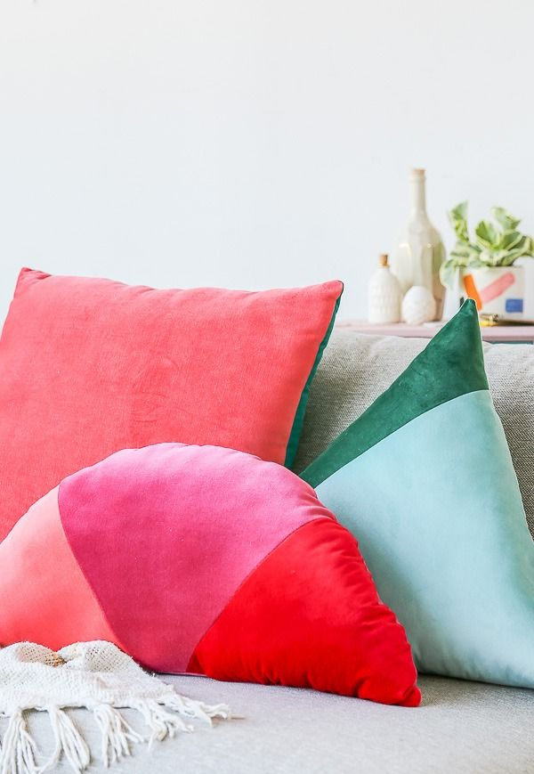 With velvet having a major moment in the fabric realm, we're in love with these DIY color blocked pillows from Paper & Stitch in pink, red, green, and blue. Whether the pillows are for your bedroom, living room, or on a chair or couch, they're the perfect decorative accent to add a handmade touch to any room.
