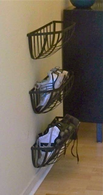 Metal planters from Home Depot turned into shoe racks.  I actually did this and not only does it work great, but I get a lot of compliments, too!