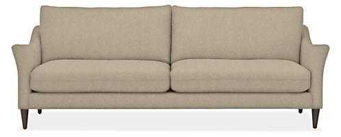 Inspired by the luxurious simplicity of Belgian modern design, our Merriam sofa perfectly balances sophistication and comfort. A centered saddled stitch on the plush seat and back cushions is not only a lovely design detail, but also encourages a soft, relaxed look. Sloping flared arms hug you in comfort as you sink into this elegant, sculptural sofa.
