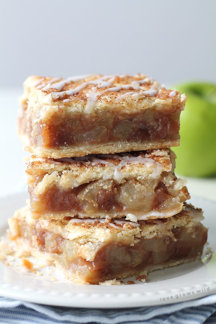 These Apple Pie Bars are the perfect handheld dessert and SO delicious! Made with fresh apples and topped with a sweet vanilla glaze!   LoveGrowsWild.com