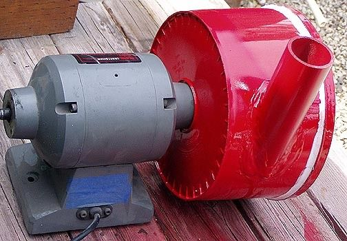 """Forge Blower by Ray Rogers -- Homemade forge blower powered by a 1/3 HP 3450 RPM motor and equipped with a 10"""" diameter blower wheel. Housing was constructed from a plastic pail and PVC. http://www.homemadetools.net/homemade-forge-blower-2"""
