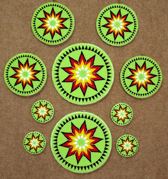 Beaded Rosettes: another beautiful design. Would look nice in blue, black, and white!