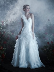 Anjolique Wedding Dress - Spring 2013 - Style A453. This glamorous organza wedding dress features a one-shoulder floral detail, a sculpted sweetheart neckline and a ruched drop-waist bodice. The skirt is a waterfall of asymmetrical organza ruffle details.