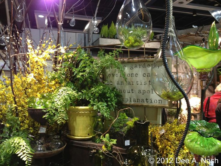 "This sign read: ""In the garden, everyone can be an artist without apology or explanation."" I wished it was for sale. Don't you love those small hanging terrariums?: Hanging Terrarium, Cloches Terrarium, Gardens Blog"