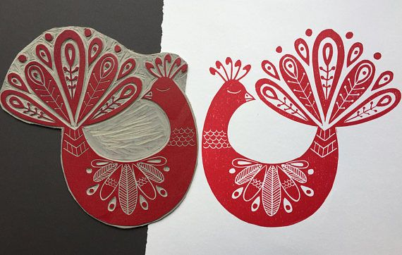 This is an open edition original hand pulled Linocut Print of a Folk Art Peacock in Magenta Red by Claire McKay