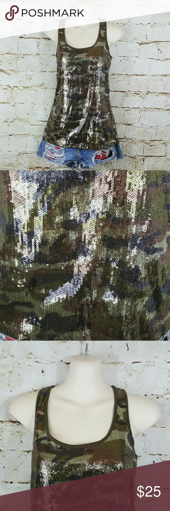 "DKNY Super sequin detailed racerback camo tank top Excellent condition like new Racerback tank top with complete outer detail in sequins. All sequins in tact. 16"" across from armpit to armpit and 26"" long from shoulder to hem the tank has lots of stretch! DKNY Tops"