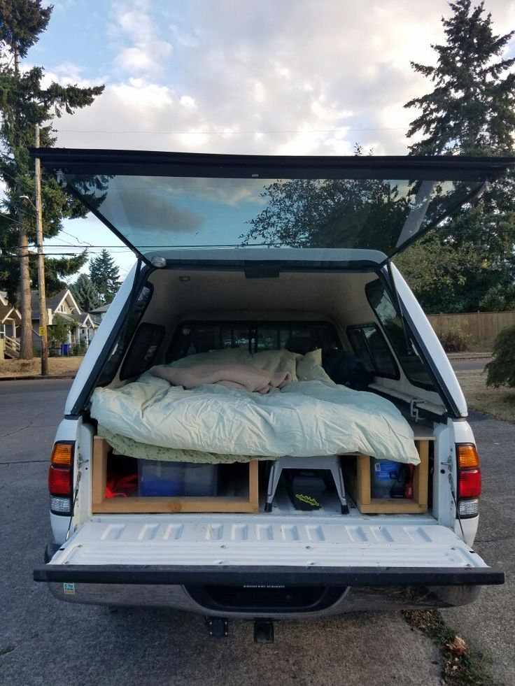 2004 Toyota Tundra SR5. DIY truck sleeping platform with roll up mattress, down comforter and gear storage.