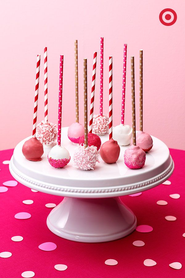 Donuts holes: they're cute, they're delicious, they're pink. Dip them in white chocolate (colored pink, of course), add coconut flakes, sprinkles and finish with Spritz straws. Such a fun and easy DIY Valentine's Day treat.