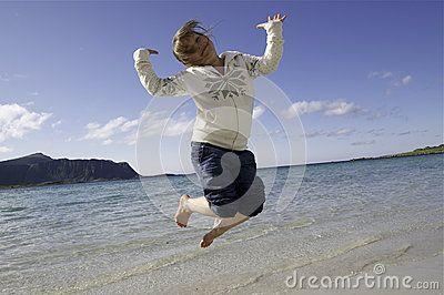 Little  girl jumping on Lofoten beach