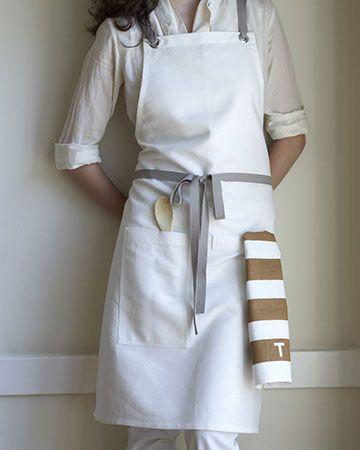 Perfect Apron (with Grommets!) $68.00 at http://studiopatro.com/tea-towels/buyme/aprons..... but I'm thinking this might be an easy sewing project