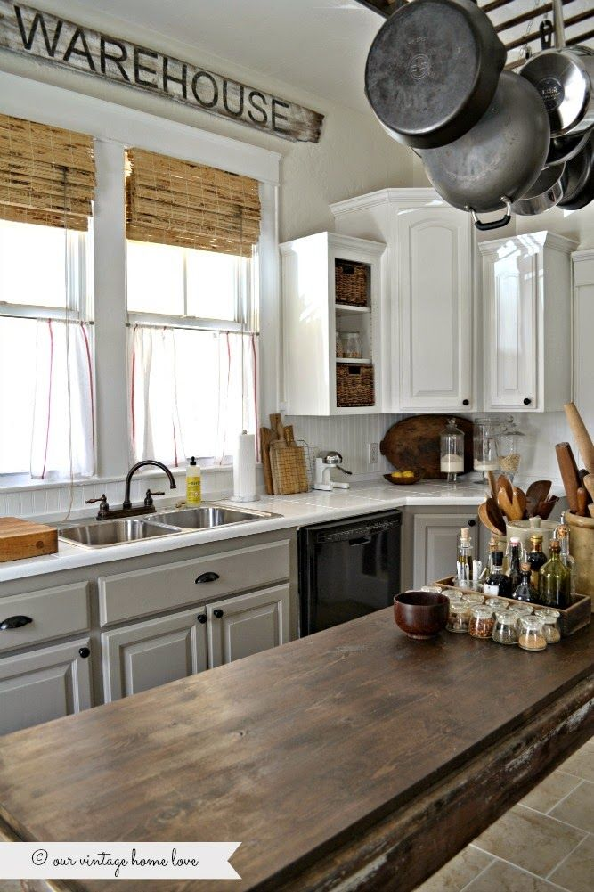 bamboo shade  painted kitchen cabinets white uppers and gray lowers with Annie Sloan Chalk Paint in french linen