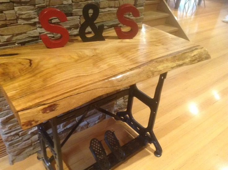 Antique Singer sewing machine base with solid timber top $350