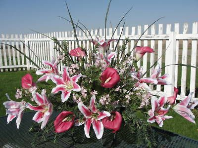 Made saddle similar to this one for Jo and Brad. Used stargazer lilies. white baby's breath and fuchsia crepe myrtle plus spikes. Made a full saddle 2 1/2 feet long. Very pretty.
