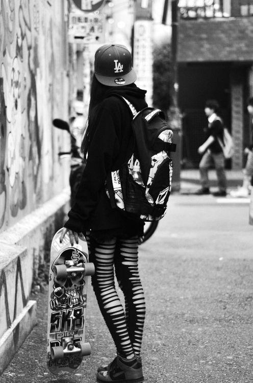 Roller skating girl pissing behind dumpster