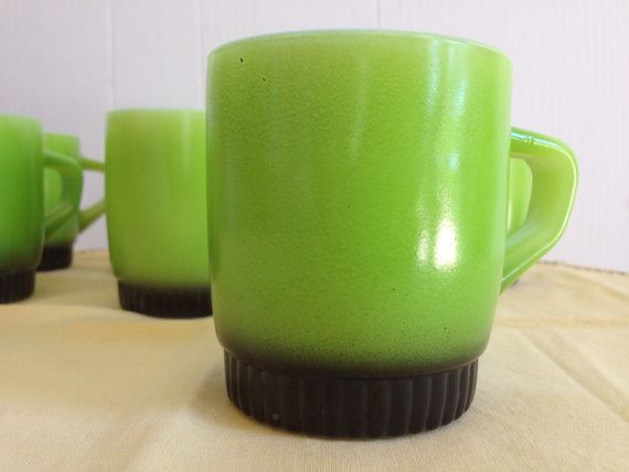 Hey, I found this really awesome Etsy listing at http://www.etsy.com/listing/163002710/vintage-fire-king-green-mugs-set-of-7