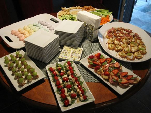 Spread for a wine party: white bean hummus, procuitto and fig crostini, pear-brie-walnut crostini, strawberry-manchego-prosciutto crostini, caprese kabobs, grapes with goat cheese and pecans, and rainbow meringues.