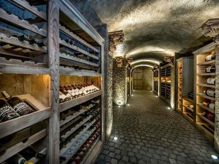 Simple lighted wood racking *** Underground wine cellar will keep bottles the perfect temperature.