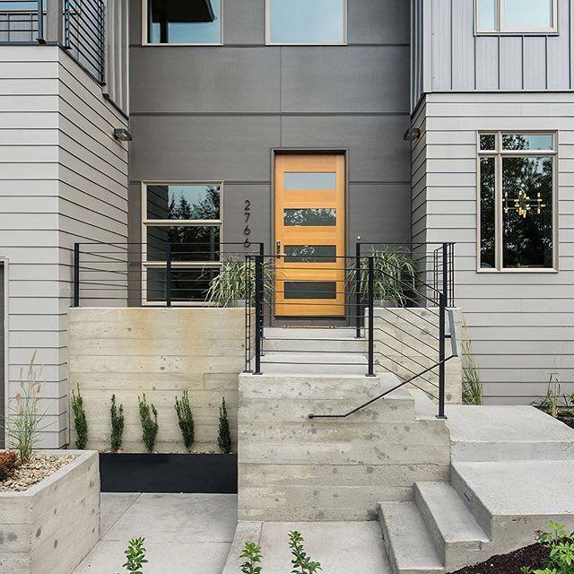 custom steel handrails, @james_hardie siding, @plygem windows and board formed concrete.