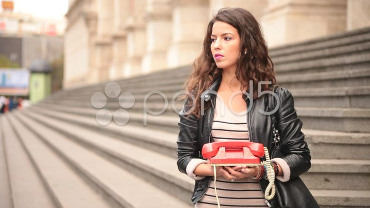 young adult woman dialing and speaking on vintage obsolete red phone - Stock Footage | by ionescu #stockfootage #communications #vintage #pond5 #woman #young