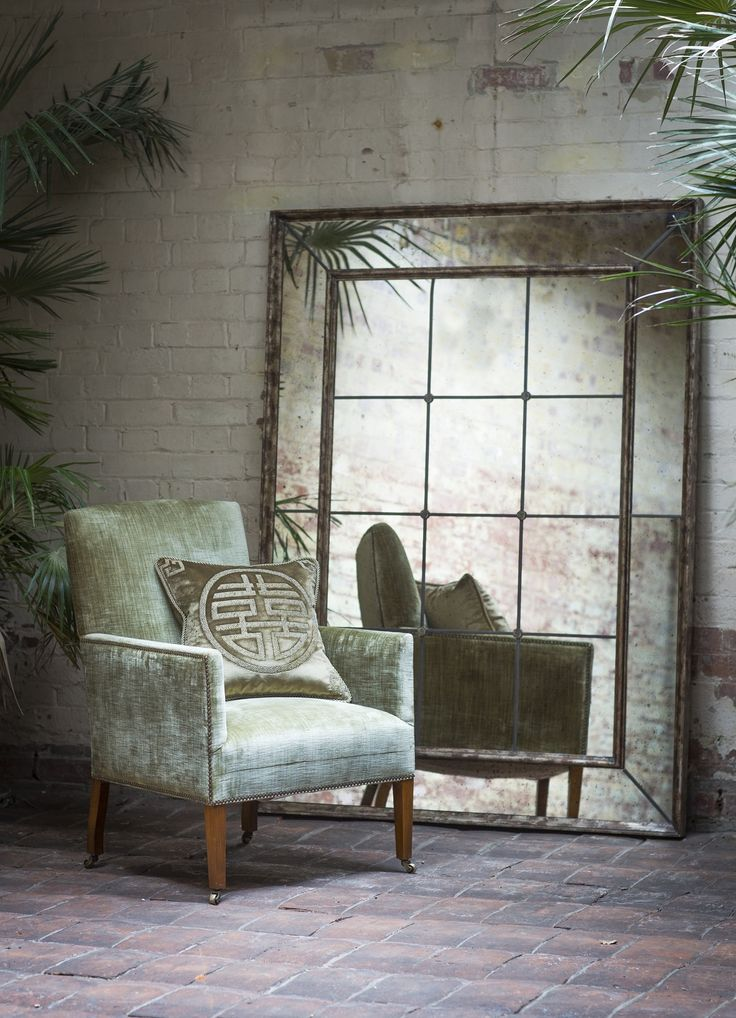 The Nicholas chair in Como velvet (Fern) with Double Happiness cushions and Panelled mirror.