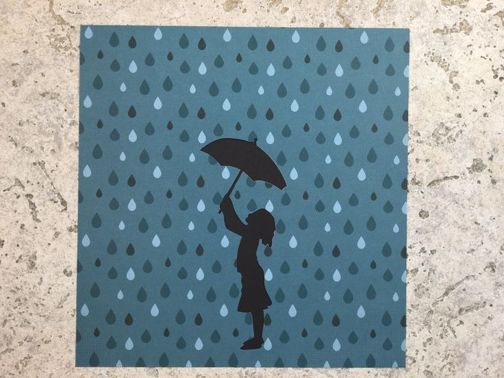 Paper cut of girl holding umbrella on raindrop scrapbook paper