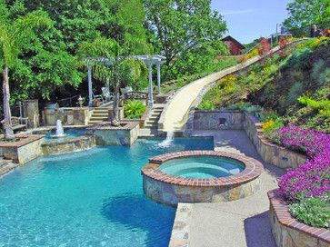 hot tub pool water fountain flowers and huge water slide best backyard ever