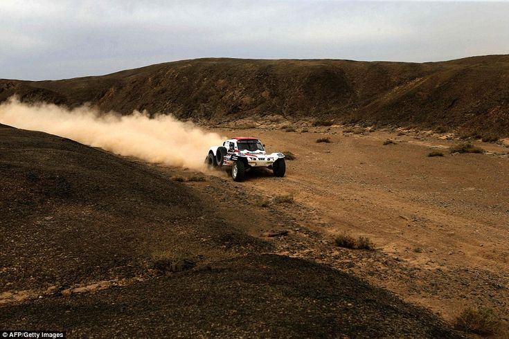 Corelis Koolen and his co-pilot Pascal Larroque drive their buggy in the Gobi Desert during the 10th stage