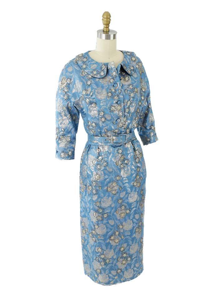1960s Designer Blue Silk Brocade Cocktail Dress. An elegant, timeless look for a wedding. Metallic floral brocade with beading, rhinestones and sequins. Larry Aldrich designer.