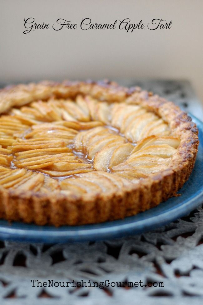 This amazing recipe for Grain Free Caramel Apple tart is so simple yet elegant. (It's also egg free, dairy free, gluten free). The cook loves it because it is easy to make, but it still makes an elegant presentation. Serve at Thanksgiving or Christmas, or anytime with a dollop of coconut whipped cream and extra homemade caramel sauce. Yum! - The Nourishing Gourmet