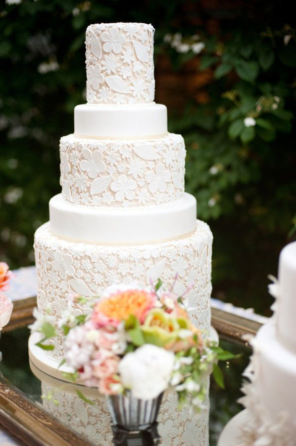 A cake with intricate layers of fondant lace.