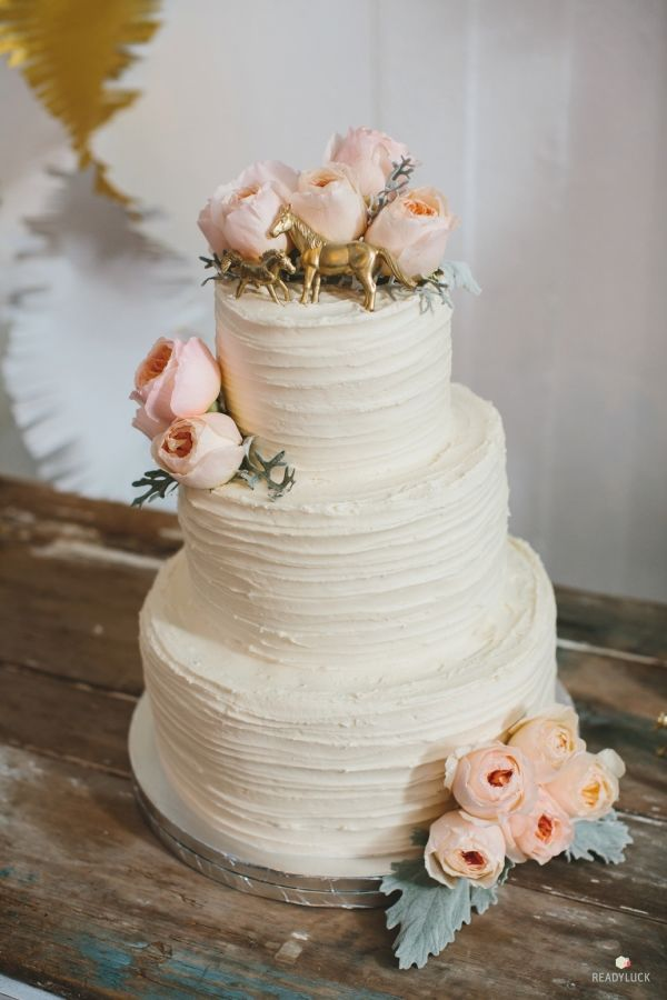 Floral and gold toy horse topped cake: http://www.stylemepretty.com/pennsylvania-weddings/wrightsville-pennsylvania/2015/09/01/rustic-vintage-inspired-pennsylvania-farm-wedding/ | Photography: Readyluck - http://www.readyluck.com/
