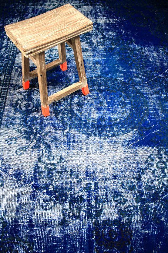 Distressed looking dyed indigo rug.