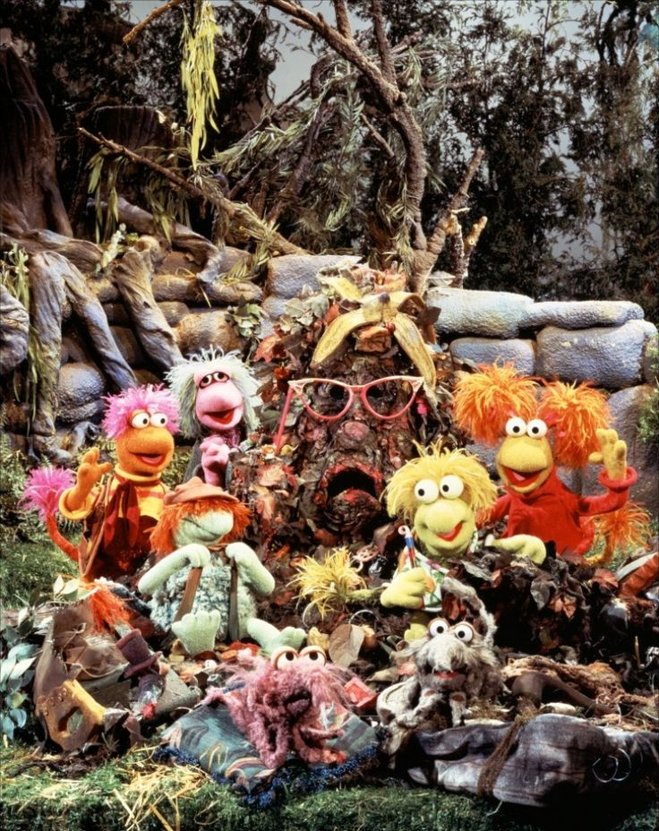 Fraggle Rock. Tiny Muppets live underground having fun all day and stealing food from a big, dumb, family of three.  Also, Marjory the Trash Heap, n-yeah.